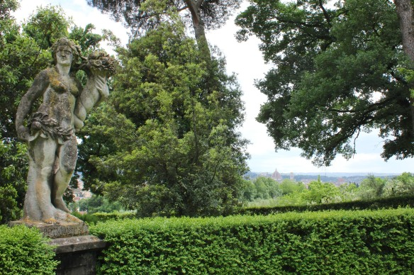 Above the tall hedges, a chance glimpse of Florence's Duomo is offered.