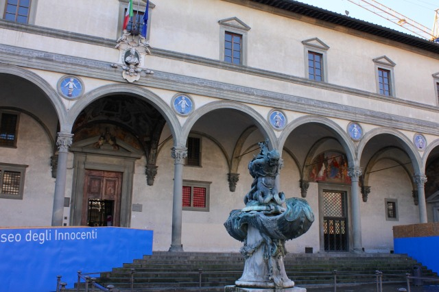 "The Museo degli Innocenti stretches along the east side of Piazza Santissima Annunziata. The ""Innocenti"" refers to the abandoned newborns that were once left at the church."