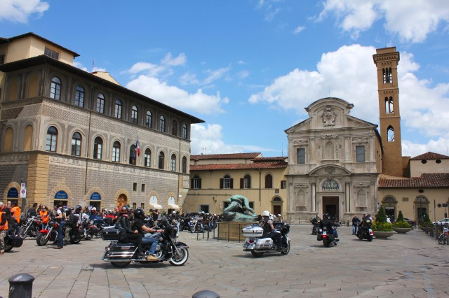 I watched, mesmerized, along with all the other passersby, as the motorcyclists roared around the piazza.