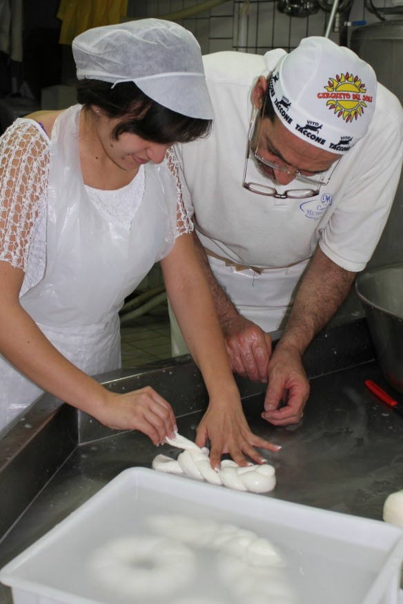 Making a treccia (braid) at a mozzarella factory in Sorrento.