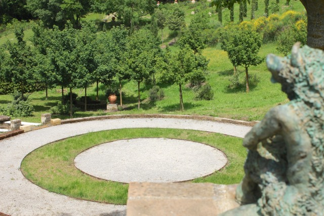 """The Centre of the Universe"".  Stand in the middle of the circle and see for yourself. Statues throughout the property are by Sheppard's wife, Francis Lansing."