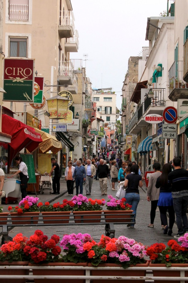 On the island of Ischia, geranium barriers block all traffic from the main road for the evening passeggiata.