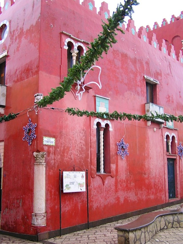 La Casa Rossa (Red House) decorated for Christmas.