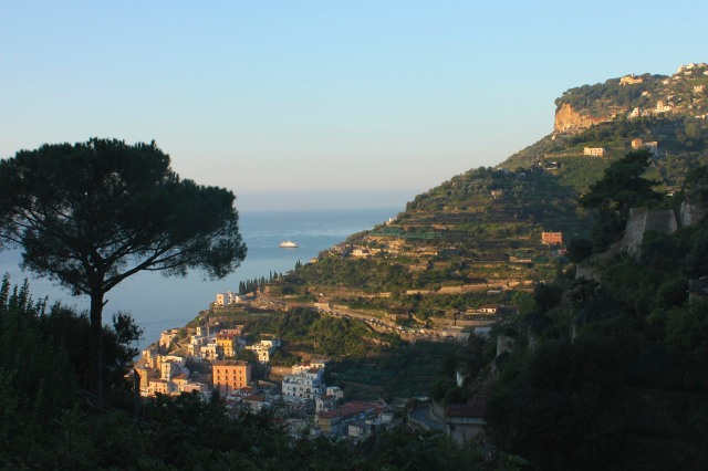 The first rays of sun light up the gardens of Villa Cimbrone, perched on the cliff to the far right.
