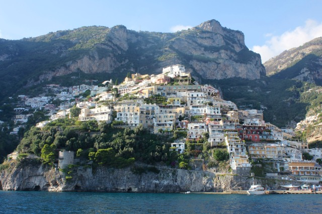 The villas of Positano follow the contours of the mountains to the was t and west of the tiny harbour.  west