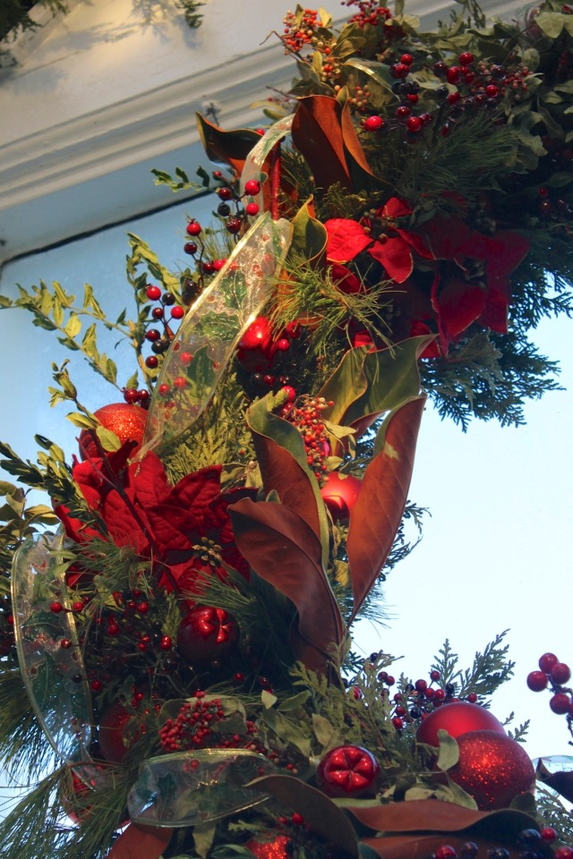 Detail of enormous wreath hanging over entrance.