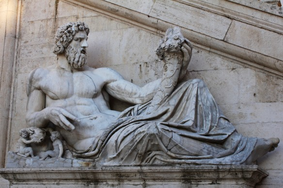 oN the other, the Tiber, with the legendary founders of Rome, Romuls and Remus.